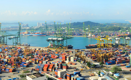 aerial: SINGAPORE - MARCH 07, 2013: Singapore industrial port. It is the worlds busiest port in terms of total shipping tonnage, it tranships a fifth of the worlds shipping containers.