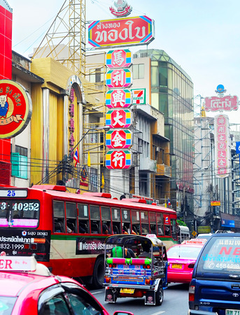 reign: BANGKOK, THAILAND - MARCH 04, 2012: Busy Yaowarat Road in Bangkok. Yaowarat Road is a main street in Bangkoks Chinatown, it was opened in 1891 in the reign of King Rama V.