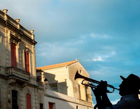 arles: Silhouette of a trumpeter on Arles street, France