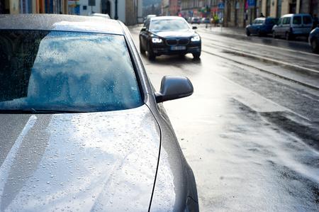 Cars on a rainy street of Krakow, Poland photo