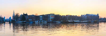 amstel: Panorama of Amsterdam old town with reflection in Amstel river