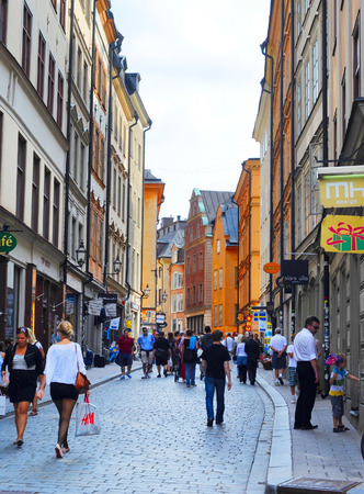 STOCKHOLM, SWEDEN - AUGUST 10, 2010:  The long Vasterlanggatan the central shopping street of Gamla Stan. Gamla Stan is the well-preserved old town centre of Stockholm.