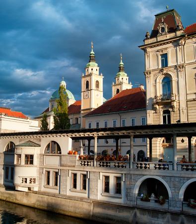 ljubljana: Ljubljana central market and Cathedral with moody sky. Slovenia