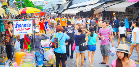BANGKOK, THAILAND - MARCH 03, 2013: People shopping in Chatuchak weekend market in Bangkok, Thailand.  It is the largest market in Thailand.