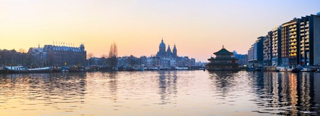 amstel river: Panorama of Amsterdam old town with reflection in Amstel river