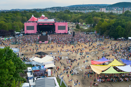 BUDAPEST, HUNGARY - AUGUST 13, 2014: Visitors of Sziget music festival in front of the main stage. Sziget is one of biggest festivals in Europe