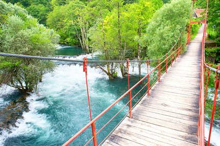 Suspension bridge over the river. Martin Brod, Bosnia and Herzegovina photo