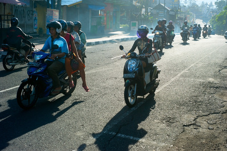 centres: UBUD, BALI ISLAND, INDONESIA - MARCH 14, 2013: Traffic on the Ubud road during rush hour. Ubud is one of Balis major arts and culture centres, it has developed a large tourism industry  Editorial