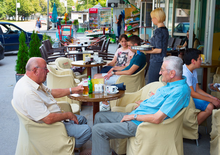 bosnia: BANJA LUKA, BOSNIA AND HERZEGOVINA - JULY 28, 2014: People at a street restaurant in Banja Luka. Banja Luka is the second largest city in Bosnia and Herzegovina , famous tourists attraction. Editorial