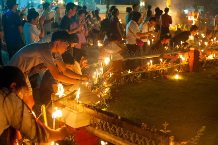 CHIANGMAI, THAILAND- Feb 14, 2013: Unidentified people lights candles at Wat Phan Tao Temple, Chiangmai
