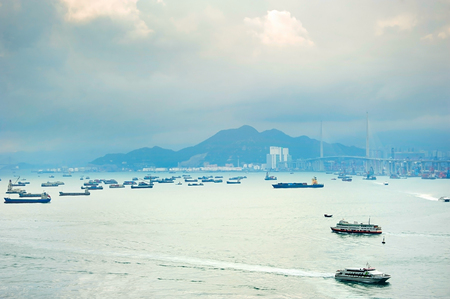 Hong Kong bay with a lot of ships. Tsing Ma bridge on the right.