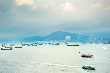 ma: Hong Kong bay with a lot of ships. Tsing Ma bridge on the right.