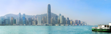 hk: Panoramic view of Hong Kong island with ferry boat from Kowloon island