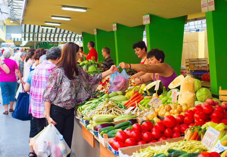 BANJA LUKA, BOSNIA AND HERZEGOVINA - AUGUST 01, 2014: : Hawkers are selling fruits in local market in Banja Luka. Banja Luka is the second largest city in Bosnia and Herzegovina
