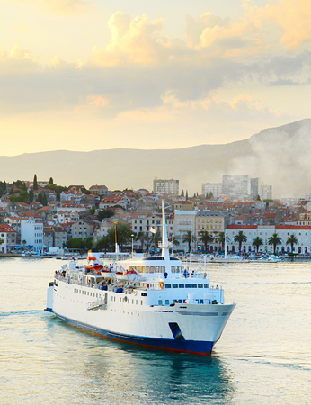 Cruise ship in a Split harbor at sunset. Croatia photo