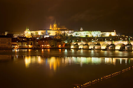 Night view of the Prague castle with reflection in Vltava river, Czech republic