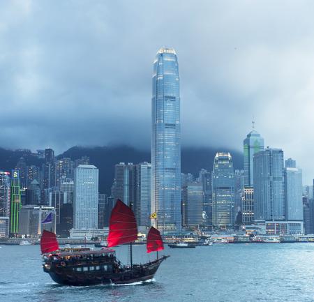 Traditional sailboat sailing in Victoria harbor . Hong Kong photo