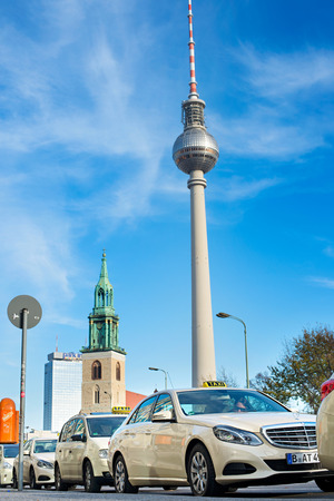 BERLIN, GERMANY - NOVEMBER 15, 2014: Taxi waiting in line for a clients. Berlin TV Tower on the background.