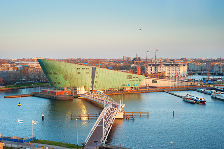 popular science: AMSTERDAM, NETHERLANDS - MARCH 11, 2014: Science Center Nemo is a science center - located at the Oosterdok in Amsterdam-Centrum ( designed by Renzo Piano since 1997). Editorial