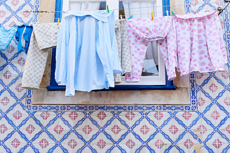 clothesline: Drying clothes hanging on a clothesline in Lisbon, Portugal