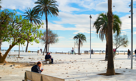 10 best: BARCELONA, SPAIN - DEC 17, 2014: Unidentified people at Barcelona city beach. 400 meters long, it is one of 10 best urban beaches of the world.