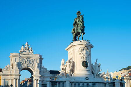 Statue of King Jose I and Rua Augusta Arch in Lisbon, Portugal photo