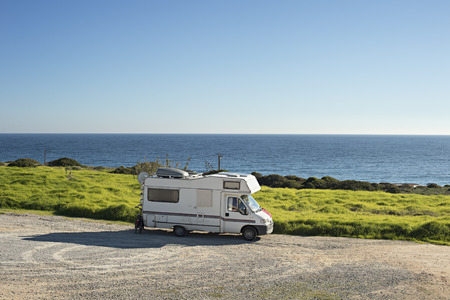 Caravan on the beach in front of the ocean in Sagres, Portugal