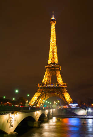 eifel: PARIS, FRANCE - JAN18, 2015: Eiffel Tower at night in Paris. The Eiffel Tower stands 324 metres (1,063 ft) tall. Monument was built in 1889, night view of the Siene River