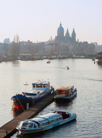 amstel: View of Amsterdam with boats on Amstel river. Holland