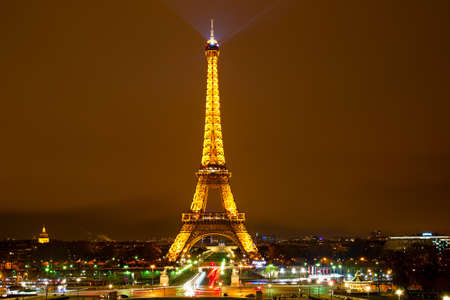 most popular: PARIS, FRANCE - JAN 18, 2015: Eiffel Tower Light Performance Show at night. The Eiffel tower is the most visited monument of France.