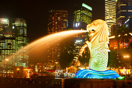 merlion: SINGAPORE - MAY 07, 2013: Closeup of Merlion Light show at Marina bay in Singapore. Merlion is an imaginary creature with the head of a lion and the body of a fish, used as a mascot of Singapore. Editorial