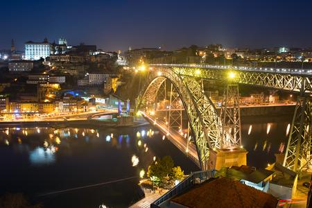 luis: Famous Dom Luis I bridge in Porto at twilight. Portugal