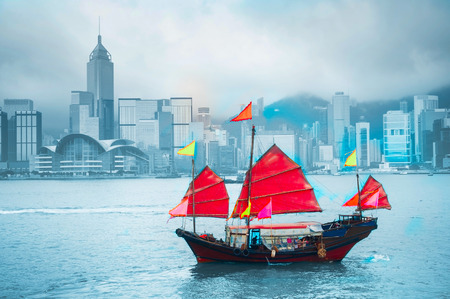 Symbol of Hong Kong - traditional wooden sailboat in Victoria harbor. photo