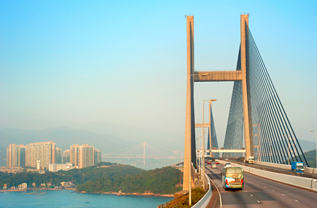 Traffic on Tsing Ma bridge at sunset. Hong Kong Imagens