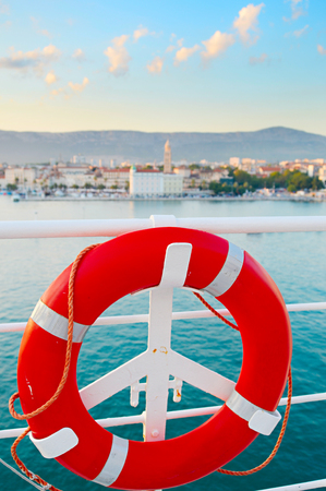 ship deck: Lifebuoy on the ship deck. Split Old Town on the background. Croatia