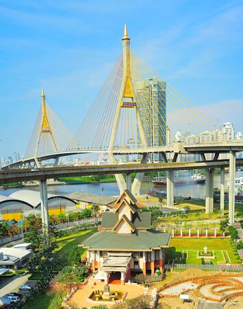industrail: Buddhist temple under the Industrail Ring Road bridge. Bangkok, Thailand