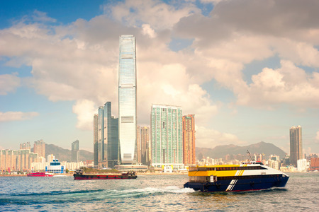 hk: Ships in Hong Kong harbor. View of Kowloon island