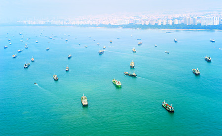 A lot of cargo ships in Singapore harbor. Top view 写真素材
