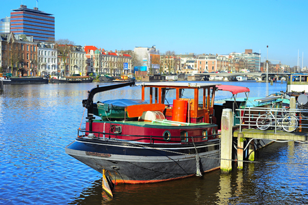 amstel river: Houseboat on the canal of Amstel river in Amsterdam, Netherlands