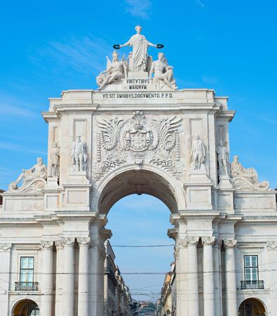 View of Rua Augusta Arch at sunset in Lisbon, Portugal photo