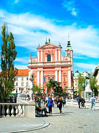 LJUBLJANA, SlOVENIA - SEPT 02, 2013 : People walking at Triple Bridge and Preseren Square in Ljubljana, Slovenia - famous tourist destination.