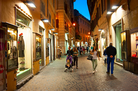 shopping buggy: ROME, ITALY - SEPT 28, 2013: Tourists walking on the Old Town street of Rome. More than 6 million of international tourists visit Rome every year.