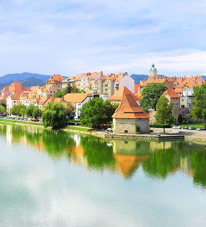 drava: View of Maribor with reflection in the Drava river, Slovenia Editorial