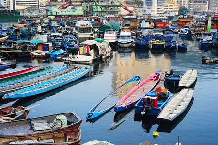 Aberdeen - famous to tourists destinaton for its floating village and floating seafood restaurants. Hong Kong Stock Photo