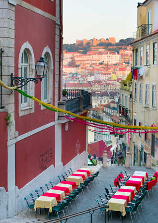 old street: Old Town street with outdoor restaurant. Lisbon, Portugal
