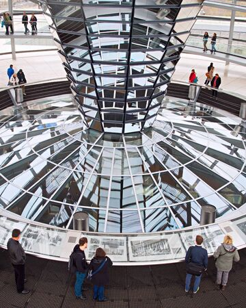 dome building: BERLIN, GERMANY - NOVEMBER 15, 2014: People visiting Reichstag dome in Berlin, Germany. The Reichstag dome is a glass dome constructed on top of the rebuilt Reichstag building