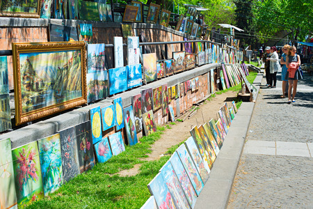 TBILISI, GEORGIA - MAY 06, 2015: Paintings at Dry Bridge Market in downtown of Tbilisi. The Market is the famous flea market and popular tourist attraction.