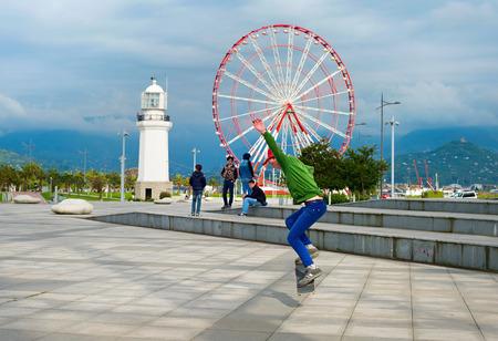 ferries: BATUMI, GEORGIA - MAY 11, 2015: Group of skateboarders on the embankment of Batumi. Batumi - city on the Black Sea coast and capital of autonomous republic Adjara, Georgia.