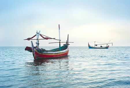 ocean fishing: Traditional indonesian fishing boats in the ocean, Jawa island, Indonesia