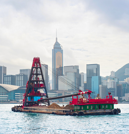 tonnes: Barge in front of business district in Hong Kong. Some 456,000 vessels arrived in and departed from Hong Kong during the year, carrying 243 million tonnes of cargo